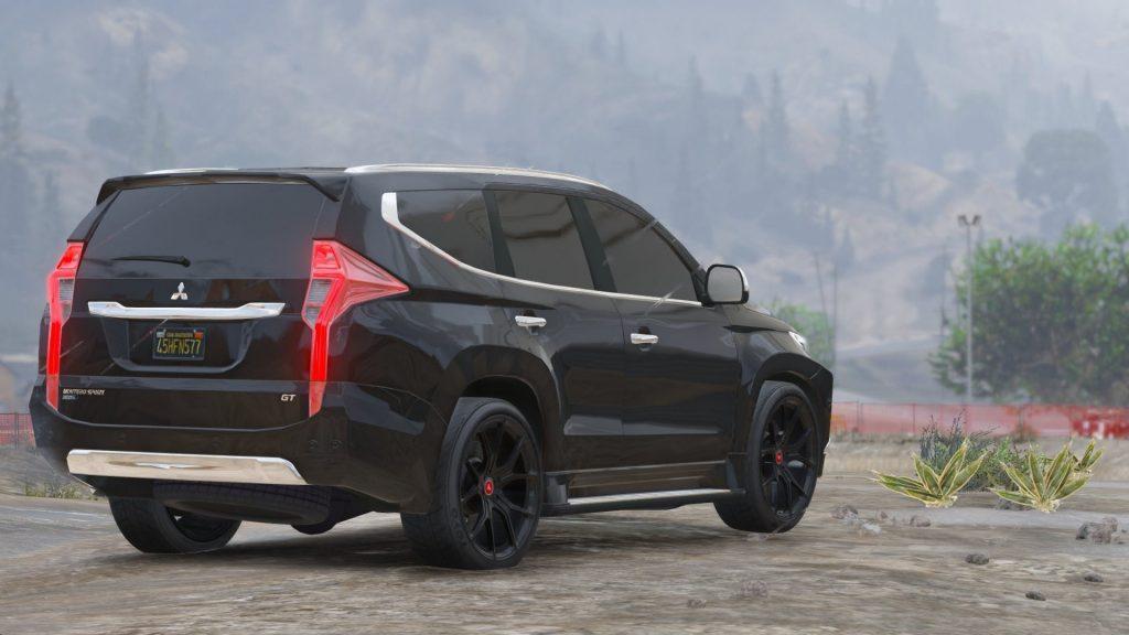Mitsubishi Pajero Sport вид сзади