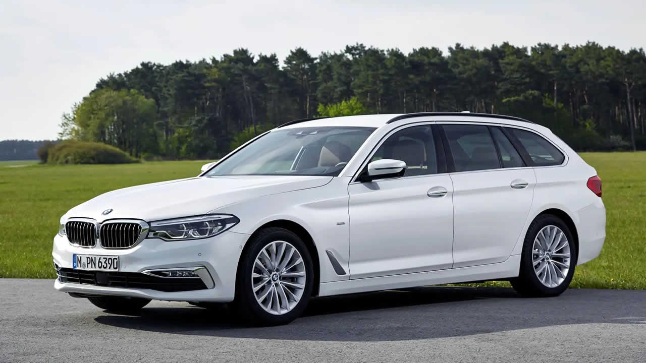 BMW 5-Series Touring 2019 - Вид сбоку